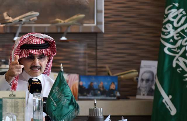 Saudi Arabia's billionaire Prince Alwaleed bin Talal gestures during a press conference in the Saudi capital, Riyadh, on July 1, 2015.