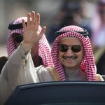 In this Feb. 4, 2014 file photo, Saudi billionaire Prince Alwaleed bin Talal waves as he arrives at the headquarters of Palestinian President Mahmoud Abbas in the West Bank city of Ramallah. Three associates of Saudi Prince Alwaleed bin Talal say the billionaire investor has been released after nearly three months in detention at a luxury hotel as part of an anti-corruption sweep. The associates told The Associated Press that the prince was released on Saturday Jan. 27, 2018.