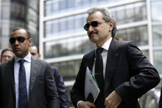 Prince Alwaleed Bin Talal, Saudi billionaire and founder of Kingdom Holding Co., right, arrives to give evidence at the High Court in London, U.K., on Monday, July 1, 2013.