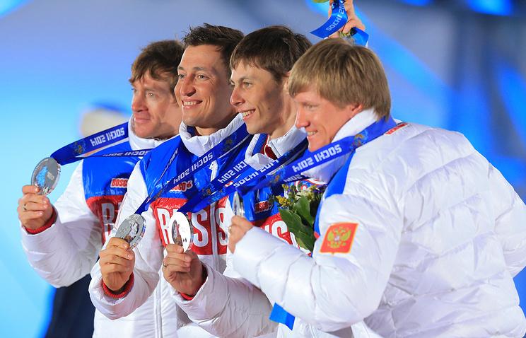 Российские лыжники Максим Вылегжанин, Александр Легков, Александр Бессмертных, Дмитрий Япаров (слева направо)