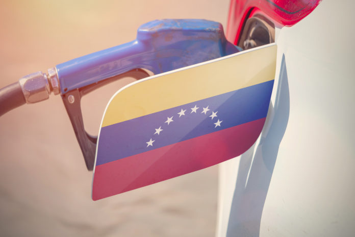 Gas pumped into the car with the Venezuelan flag on its fuel cap