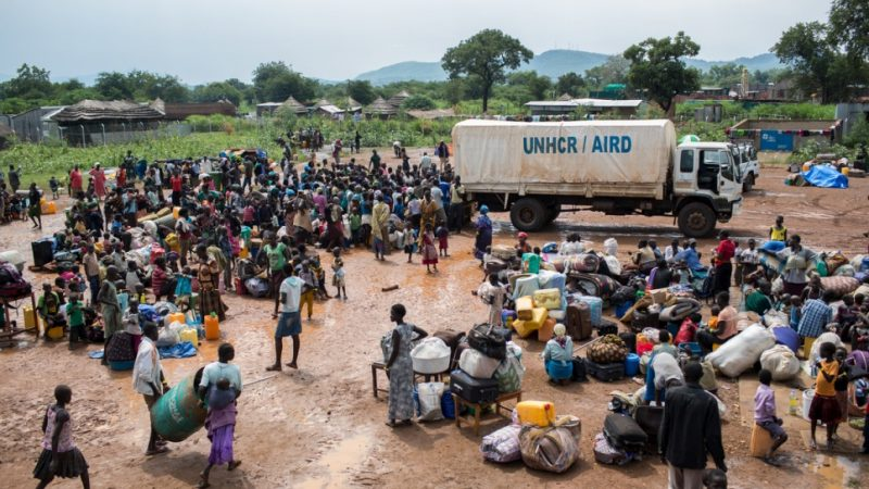 South Sudanese refugees gather at a UNHCR collection centre on the South Sudan border in Egelo, Uganda.