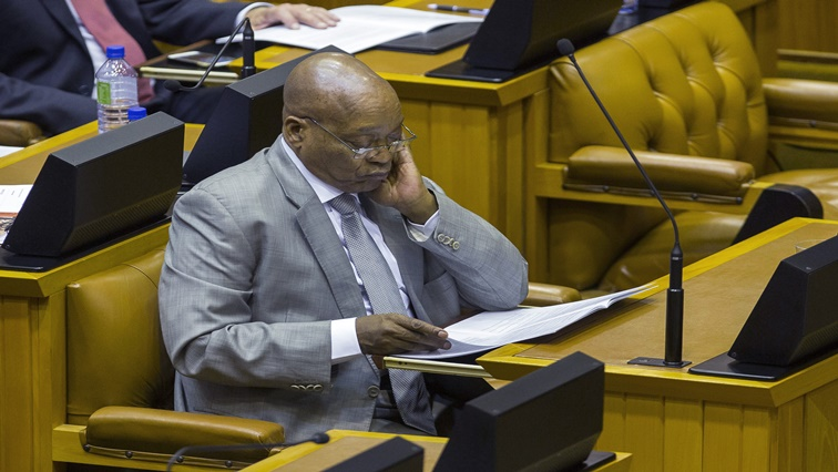 Jacob Zuma, South Africa's president, looks at a document as he attends the annual budget speech at the parliament in Cape Town, South Africa, on Wednesday, Feb. 22, 2017. South Africa's Finance Minister Pravin Gordhan cut his spending ceiling and stuck to deficit targets, holding his ground in a feud with Zuma for control of the nations finances.